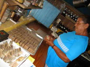 A local woman wrapping the individual bars of soap.