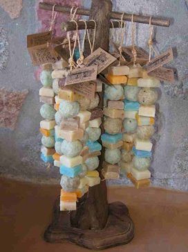 Soap Collar Display: A rustic rack hung with strings of small soaps.