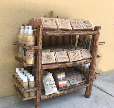 Rustic shelving designed to show off the Desert Soaps line of soaps.